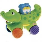 Игрушка Fisher-Price Веселые животные на колесиках с сюрпризом Крокодильчик. Характеристики.